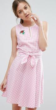 Trollied Dolly , Gingham Skater Dress With Tie Waist And Rose Badge Pink